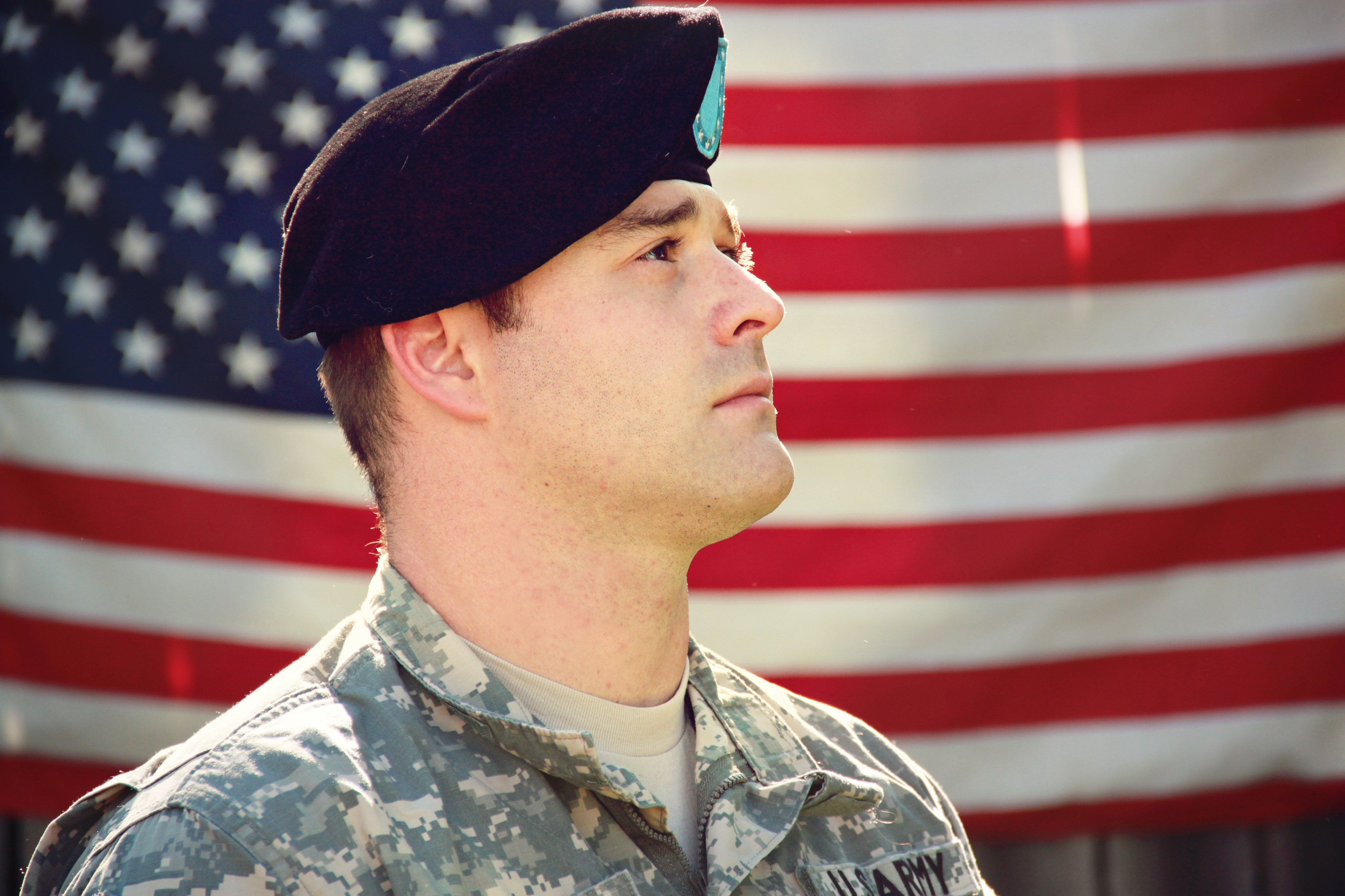 Canva - Man Wearing Combat Hat And Top Looking Up Near Flag Of America